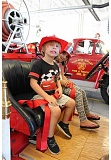 SPOKESMAN PHOTO: JAKE BARTMAN - Phoenix Jones, age 3, and his sister Brooklynn, age 5 enjoyed exploring a restored 1929 fire truck that was on display for the open house. The truck was once used by the City of West Linn, but now spends most of its time housed in Wilsonville at Station 56.