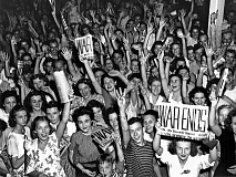 WIKIPEDIA - Historic times in America - In this archive photo young people celebrate the Victory in Europe or V-E Day in 1945.