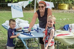 NEWS-TIMES PHOTO: JOHN MYERS - Zach Wrublewski, 4, of Forest Grove (left) works on making a fish-print t-shirt with help from his mom and his brother James, 5, at the Tualatin Soil and Water Conservation District tour and BBQ.