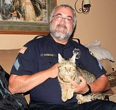 SUBMITTED PHOTO: DAVE KEMPAS - West Linn Police Sergeant Dave Kempas and his cat, Tigger, gained international with tales of Tigger's kleptomania.