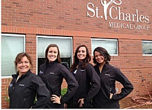 SUBMITTED PHOTO - Clinic doctors, from left, Patricia Spencer, Jinnell Lewis, Shilo Tippett, and Aimee Neill pose in front of the Family Care Clinic, next to St. Charles Madras. The clinic is celebrating its first anniversary.