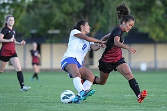 HILLSBORO TRIBUNE PHOTO: AMANDA MILES - Hillsboro's Eileen Reyna and Glencoe's Claire Graves battle for possession of the ball during Hilhi's 7-2 win on Wednesday at Hillsboro High School.