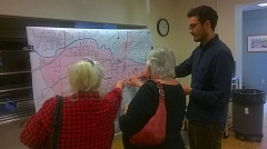 TIMES PHOTO: MARK MILLER - Alex Page, right, shows two attendees at a transit workshop in the Juanita Pohl Center where to place their stickers on a map of Tualatin.