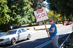 TRIBUNE FILE PHOTO - A Portland protester takes to the streets during the actions against Shell Oil here in July.