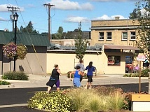ESTACADA NEWS PHOTO: EMILY LINDSTRAND - A group of runners near the finish line.