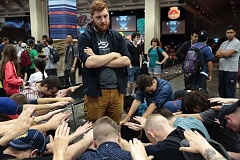 PHOTO BY: DOUG MORISOLI - A photographer from Pennsylvania who comes to Pokemon events to support his children playing came up with the idea to show other players worshiping Jacob Van Wagner after he won the world tournament.