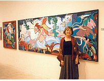 SUBMITTED PHOTO - The late artist Jeanie Smith stands next to one of her large, colorful murals.