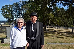NEWS-TIMES PHOTO: MICHAEL SPROLES - Dr. Bob Nixon and his wife Jean pose at Mountain View cemetery in Forest Grove, where Nixon will play his grandfather, Dr. Robert Nixon, also a dentist, during Saturdays Grave Matters event.