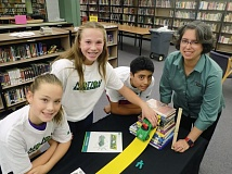 BEAVERTON VALLEY TIMES: RAY PITZ  - Anneliese Bishop, Lanie Lischke and Oswaldo Martinez, all eighth-graders at Highland Park Middle School, try out the Motion Commotion science kit as part of the 4-H National Youth Science Day thats set for Oct. 7.