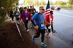 COURTESY PHOTO BY FREEZE FRAME PHOTOGRAPHY - Community members jog in last year's Regatta Run in Tualatin. The annual event honors Cpl. Matt Lembke, a Tualatin High School alumnus who was killed in action while on a tour of duty in Afghanistan six years ago.