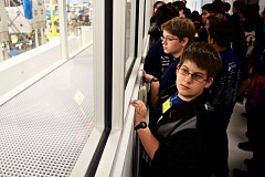 TIMES PHOTO: JAIME VALDEZ - Students from Tualatin High School watch as employees at Lam Research Corp. produce semiconductor parts in Tualatin.
