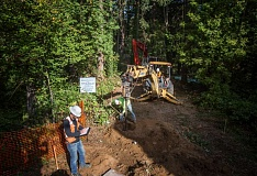 TIMES PHOTO: JON HOUSE - Holes are drilled to build a ramp that will connect the Greenway Trail with the back of Nyberg Woods.