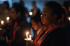 OUTLOOK PHOTO: JOSH KULLA - A Mount Hood Community College student holds a candle in honor of the nine persons shot and killed last week at Umpqua Community College in Roseburg. It was part of an effort to honor the fallen at community colleges across Oregon.