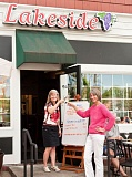 FILE - Lakeside Bistro owner Betsy Nelson and waiter Helga Saitowitz share a toast in 2013.