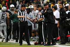 TRIBUNE PHOTO: DAVID BLAIR - Oregon coach Mark Helfrich tries to get a point across with the officials.