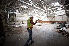 TRIBUNE PHOTO: JONATHAN HOUSE - Dave Obern walks through a building on the old Centennial Mills site that will be saved. Three of the buildings will be spared from demolition.