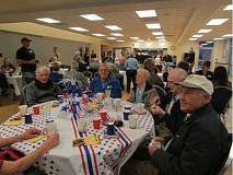 COURTESY OF THE CITY OF TUALATIN - Veterans and other attendees enjoy each other's company at the 2013 Veteran Recognition Breakfast in the Juanita Pohl Center.