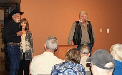 HOLLY SCHOLZ - Dave and Peggy Franke share their story of how alcoholism controlled their lives. Prineville author Rick Steber, standing at right, hosted a book-signing event with the Frankes at the Bowman Museum on Tuesday evening, Oct. 12.
