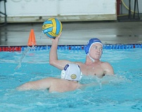 JEFF WILSON/THE PIONEER - Josh Hocker eyes the net during Madras' water polo game against Sunset Friday at the Madras Aquatic Center.