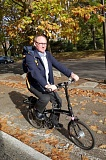 COURTESY: DAWN RICHARDSON - Portland Tribune writer Joseph Gallivan tests out one of the foldable ebikes on a nice fall day.