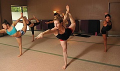 STAFF PHOTOS: VERN UYETAKE  - At center, Angela Patrick, owner of Bikram Yoga of Happy Valley and West Linn, is hosting the Oregon Regional Yoga Asana Championship to take place Nov. 15 at Oregon Golf Club.