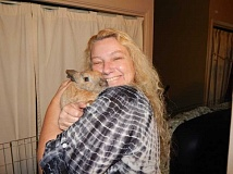 BARBARA SHERMAN - Carolyn Ackerman, holding Sunshine, rescued five bunnies in Hawaii and lived there until she was able to fly them to Oregon in the passenger cabin and not in the cargo hold.