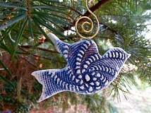 SUBMITTED PHOTO - Beginning Dec. 1, look for Dorothy Steeles porcelain doves throughout Lake Oswego. The collectible ornaments are yours to keep, but also earn finders receive a customer reward at the Holiday Gallery.
