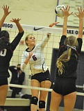 MATTHEW SHERMAN - Lake Oswego's Elise Anderson looks to knock a ball through Glencoe's block in last week's playoff match.