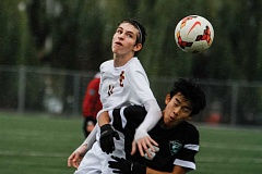 HILLSBORO TRIBUNE PHOTO: CHASE ALLGOOD - Century defender Justin Khamphilavong fights Central Catholic's Charlie Raymond for the ball during Century's 0-2 loss Saturday.