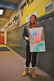POST FILE PHOTO - Cedar Ridges Ashley Alex shows off her winning Share Peace poster.