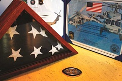 POST PHOTO: KYLIE WRAY - For his 70th birthday, Terry Hescock received a dedicated flag and other mementos in honor of his son Christian Hescock, who died in 2007.