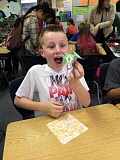 SUBMITTED PHOTO - Nico Colyer reacts to completing a piece of oragami at Boeckman Creek Primary Monday, Nov. 2.