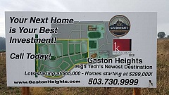 COURTESY PHOTO - This sign sitting on Gaston Heights property still shows a new proposed elementary school off Cottonwood Street, although plans for it have been cancelled.