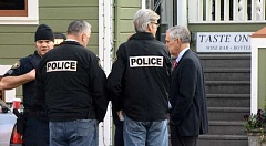 COURTESY PHOTO: KOIN 6 NEWS - Portland Mayor Charlie Hales (far right) was briefed Friday morning after a suicidal man, Michael Johnson of Forest Grove, was shot by two police officers near Legacy Good Samaritan Hospital in Northwest Portland.
