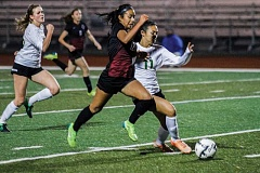 HILLSBORO TRIBUNE PHOTO: CHASE ALLGOOD - Glencoe's Celeste Molina Sanchez and West Linn's Izzy Reichner battle for a loose ball during last Wednesday's Class 6A state playoff game.