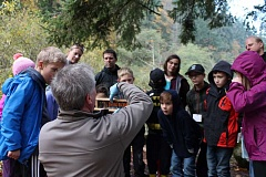 SPOKESMAN PHOTO: ANDREW KILSTROM - Oregon Department of Fish and Wildlife Fish Biologist Tom Murtagh shows Willamette third-graders the maturation process of salmon.