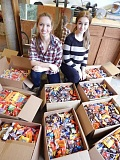 TIDINGS PHOTO: CLIFF NEWELL - Maddie Turner, left, and her sister Cammie have been incredibly busy boxing 1,000 pounds of candy to send to American troops overseas.