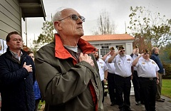 REVIEW PHOTO: VERN UYETAKE - Lake Oswego resident Bill Warner stands front and center at Oswego Pioneer Cemetery during dedication ceremonies for a new veterans service board, which bears the words 'Lest We Forget.' City Councilor Skip O'Neill is behind Warner.
