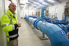 TIMES PHOTO: JAIME VALDEZ - John Goodrich, a Tigards utility manager, shows off the citys new Bonita Road pump station on Milton Court. Every drop of drinking water passes through this facility before heading to Tigard area residents.
