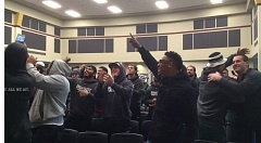 TRIBUNE PHOTO: STEVE BRANDON - Portland State players react Sunday morning at Hoffman Hall as they learn they are the No. 6 seed in the FCS playoffs.