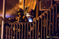 PORTLAND FIRE & RESCUE/GREG MUHR - Firefighters battle a blaze that damaged a building and dispalced three apartment residents Friday.