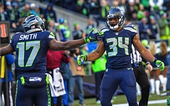 TRIBUNE PHOTO: MICHAEL WORKMAN - Thomas Rawls (right) receivers congratulations from teammate Kevin Smith after scoring Sunday in the Seattle Seahawks' 29-13 victory at home against the San Francisco 49ers.