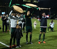 TRIBUNE PHOTO: DAVID BLAIR - Timbers players (from left) Dairon Asprilla, Norberto Paparatto and Liam Ridgewell hold up log slices after Portland outscored FC Dallas 3-1 Sunday at Providence Park.