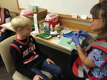 PHOTO COURTESY OF LEGACY HEALTH - A young patient prepares to get a flu vaccination at one of last year's free clinics offered by Legacy Health.