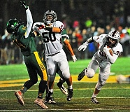 PAMPLIN MEDIA GROUP: VERN UYETAKE - Sherwood senior lineman Nathaniae Harrison (50) blocks West Linn's Zack Huffstutter, clearing the way for Gage Fuller, during the teams' first meeting this season. The rematch will be in Saturday's state  semifinal at Providence Park.