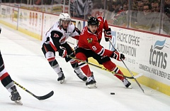 COURTESY: BRYAN HEIM - Cody Glass (right) of the Portland Winterhawks looks to control the puck during Wednesday night's game against Moose Jaw.