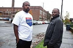 TRIBUNE PHOTO: JAIME VALDEZ - Ex-Blood Stefan Johnson's race to the hospital saved the life of Tamir Hassan Rushdan Lawrence, a Crip. Johnson, right, revisits the site of the shooting near King School with Nathaniel Williams, who recently started an organization - Unify Portland -aimed at  getting older gang members to encourage younger gangsters to rein in their violence.