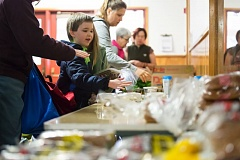 TRIBUNE PHOTO: JONATHAN HOUSE - Families come to Cherry Park Elementary in East Portland twice a week pick up food rescued by Urban Gleaners. Twenty-three local schools participate in their Food to Schools pantry program.