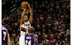 TRIBUNE PHOTO: DAVID BLAIR - Blazers guard CJ McCollum launches a jump shot over Kobe Bryant of the Los Angeles Lakers.