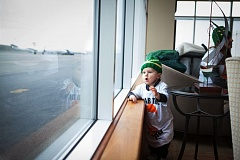 Nat Borchers' son, Lincoln, looks out the window as he awaits his father/Portland Timbers defender's arrival near Portland International Airport on Monday.